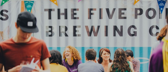 A table of people laughing and drinking outside The Five Points Brewing Company in Hackney