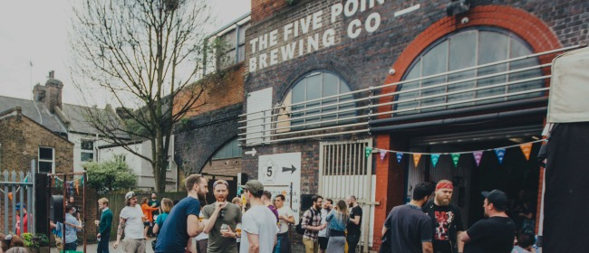 A group of people drinking beer outside The Five Points Brewing Company in Hackney, East London