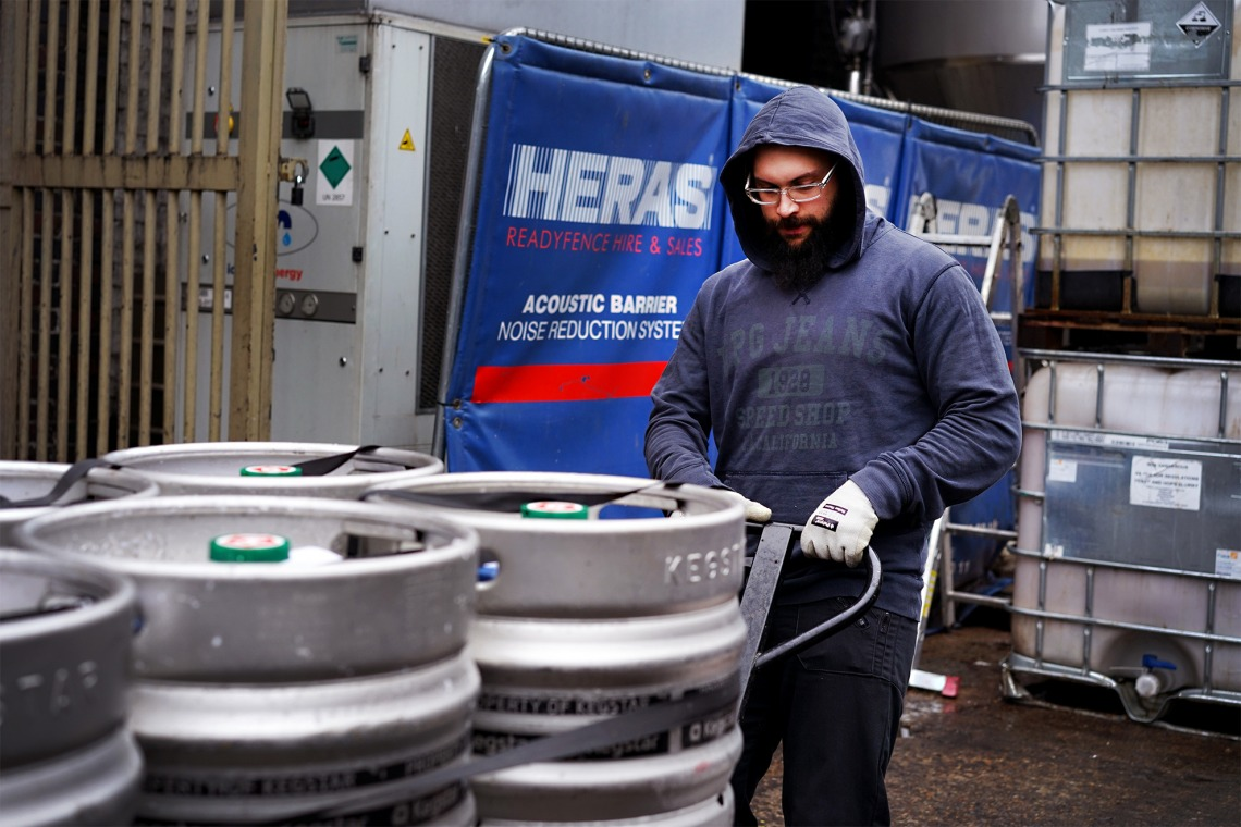 A drayperson delivering kegs